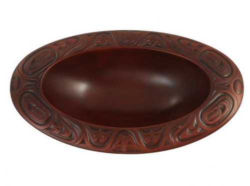 Red-brown oval serving bowl with West Coast First Nations' design.