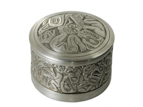 Round pewter box with West Coast First Nations' raven and sun design.