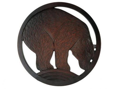 Red-brown bear in a circular frame.