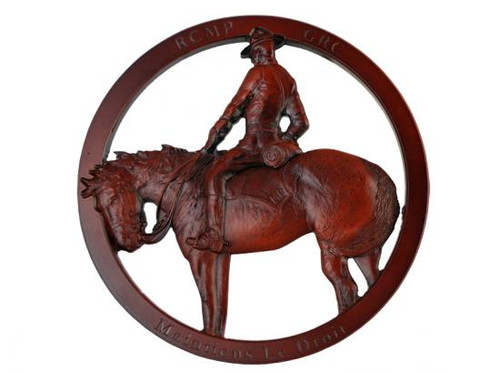 Red-brown figure on horseback in a circular frame.
