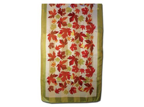 Silk scarf featuring red maple leaves on a green and cream background.