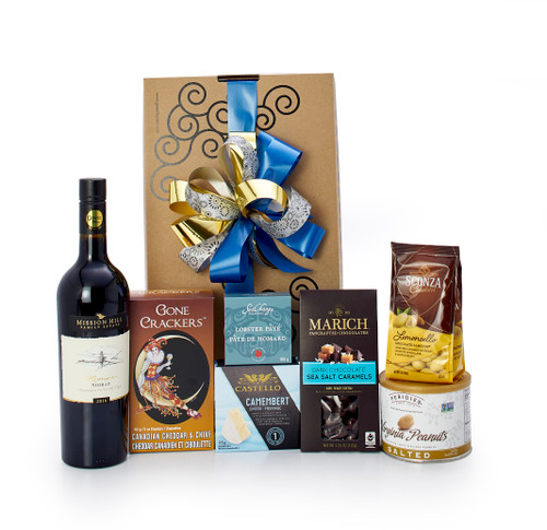 Gourmet gift basket featuring Mission Hill Reserve Shiraz, sweet and savoury snacks (chocolate, crackers, cheese, etc.), packaged in signature Green & Green gift box with ribbon and bow.