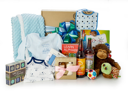 Gift basket for new baby and family, featuring blue clothing, blue blanket, blue teddy bear, toys for infant, toys for older child, two large beers (for the parents!) and a small spa set. Packed in our signature Green & Green gift box with blue ribbon and bow.