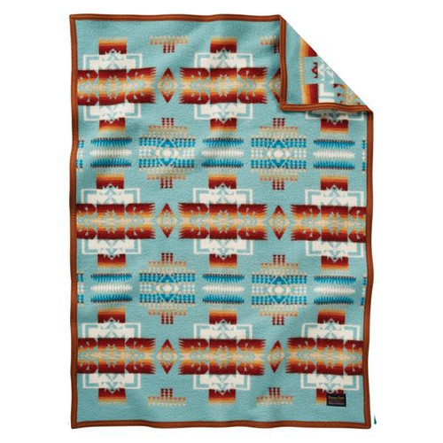 Pendleton blanket with Chief Joseph print in aqua and brown.