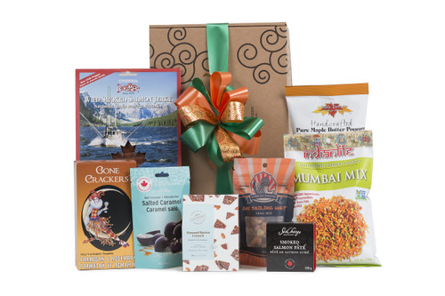 Gourmet gift basket featuring BC local snacks (chocolate, candies, crackers, smoked salmon, etc.) packaged in signature Green & Green gift box with  ribbon and bow.