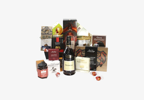 Gourmet gift basket featuring Hennessy and snacks (crackers, cheese, pate, etc.).