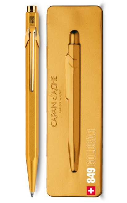 Gold pen beside pen case