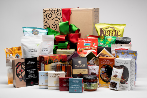 Gourmet gift basket featuring sweet and savoury snacks (chocolate, chips, crackers, pate, etc.) packaged in signature Green & Green gift box with red and green ribbon and bow.
