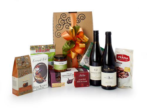 Gourmet gift basket featuring Mission Hill Family Estate Pinot Noir, Tinhorn Creek Gewürztraminer, BC local snacks (chocolate, crackers, smoked salmon, etc.) packaged in signature Green & Green gift box with ribbon and bow.
