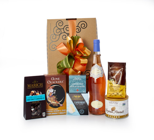 Gourmet gift basket featuring Fabre en Provence Côtes de Provence Rosé, and sweet and savoury snacks (chocolate, crackers, nuts, etc.), packaged in signature Green & Green gift box with ribbon and bow.