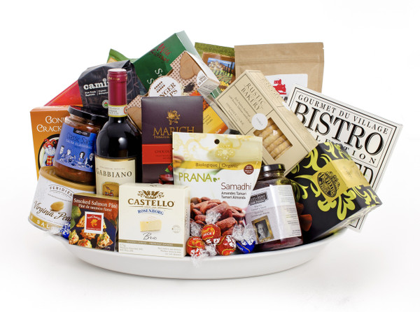 Extra-large gourmet gift basket featuring Gabbiano chianti classico, and sweet and savoury snacks (chocolates, pate, cookies crackers, nuts, antipasto, etc.), presented on a large white Revol serving platter.