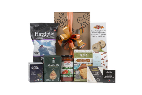 Gourmet gift basket featuring nutritious snacks (chocolate, tea, nuts, etc.) packaged in signature Green & Green gift box with ribbon and bow.