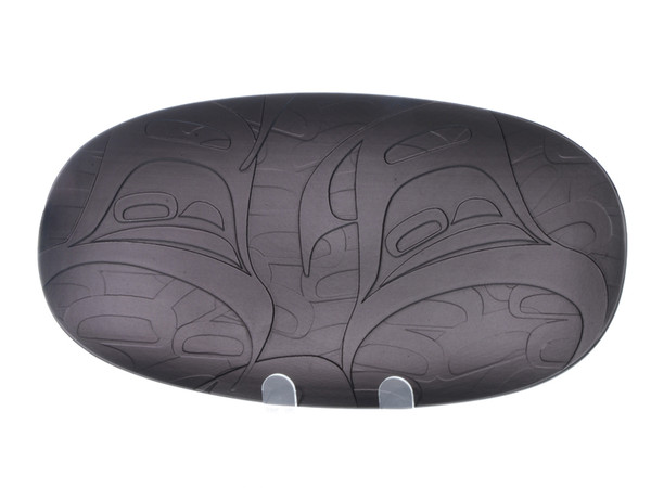 Black oval platter, etched with a West Coast First Nations abstract design.