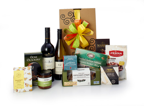 Gourmet gift basket featuring Mission Hill Reserve Merlot, Tinhorn Creek Gewürztraminer, BC local snacks (chocolate, crackers, smoked salmon, etc.), packaged in signature Green & Green gift box with ribbon and bow.