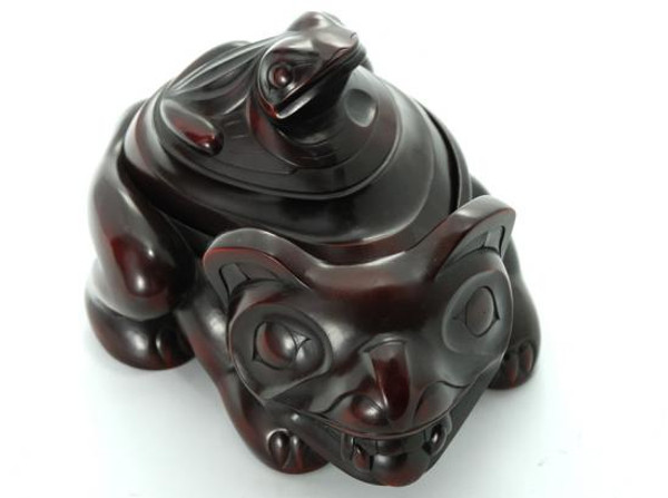 Rosewood spirit box carved in West Coast First Nations bear and frog design.