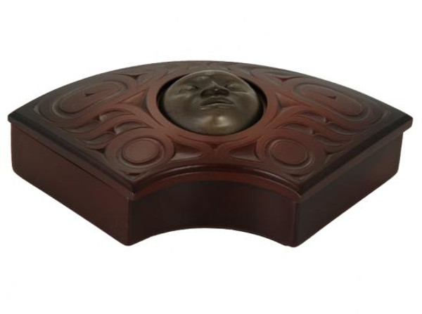 Red-brown recycled fan box with West Coast First Nations sun design.