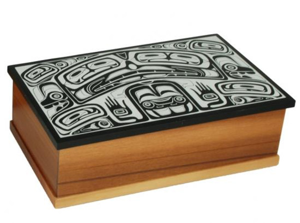 Wooden box with black marble lid and mock ivory inlay in West Coast First Nations' design.