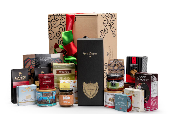 Gourmet gift basket featuring Moet & Chandon Dom Perignon champagne, and BC local snacks (chocolate, crackers, smoked salmon, etc.), packaged in signature Green & Green gift box with red and green ribbon and bow.