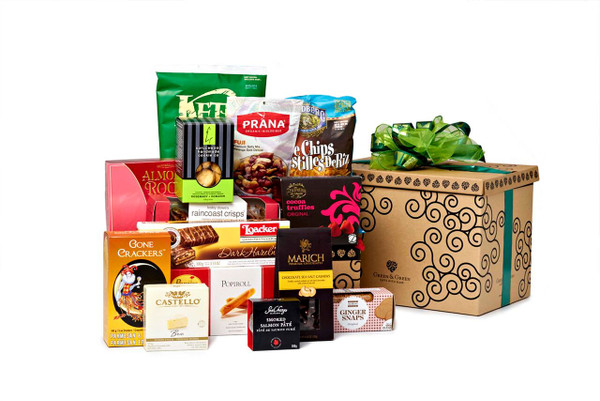 Gourmet gift basket featuring sweet and savoury snacks (chocolate, cheese, cookies, chips, etc.) packaged in signature Green & Green gift box with green ribbon and bow.