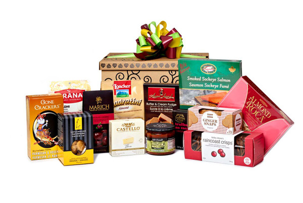 Gourmet gift basket featuring sweet and savoury snacks (chocolate, cookies, crackers, nuts, etc.) packaged in signature Green & Green gift box with red and green ribbon and bow.