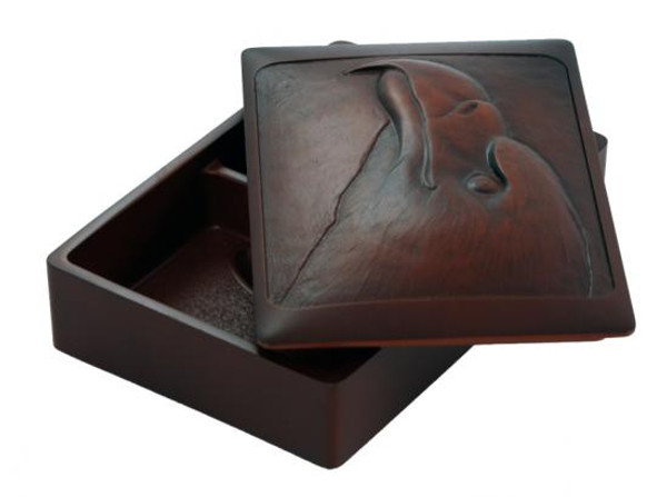 Recycled glass box carved with bald eagle design.