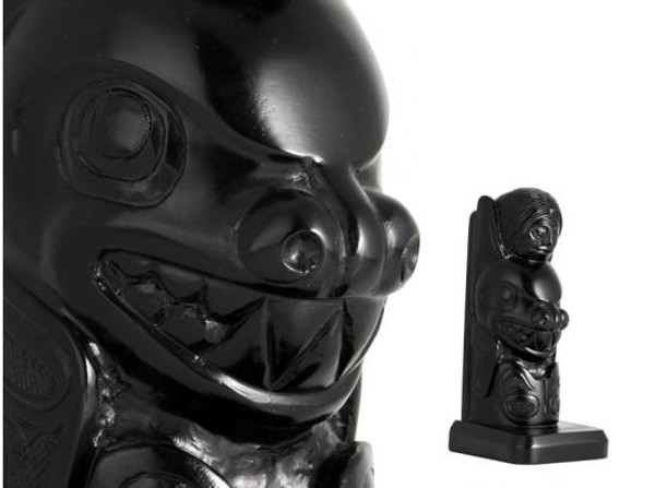 Black recycled glass bookend carved in West Coast First Nations woman and orca design.