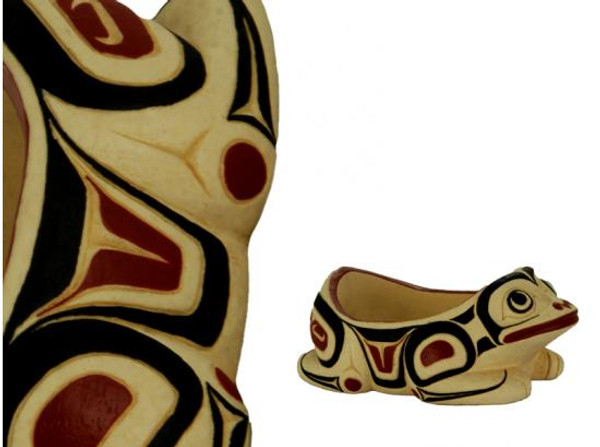 Potlatch bowl carved in West Coast First Nations frog design, with red, black, and cream colours.