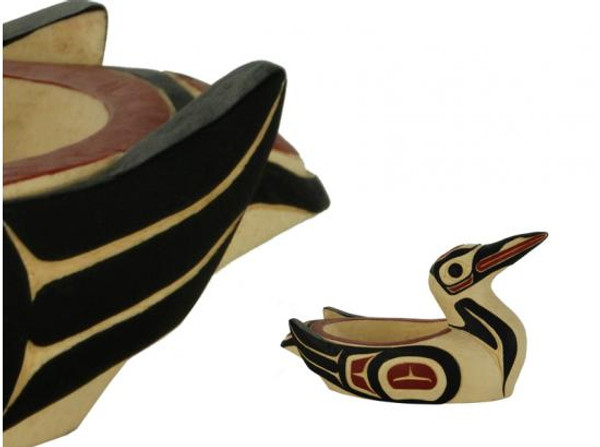 Potlatch bowl carved in West Coast First Nations' loon design, with red, black, and cream colours.