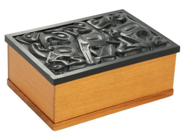 Wooden box with black marble lid and West Coast First Nations' design.