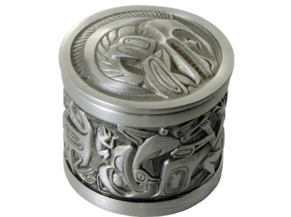 Round pewter box with West Coast First Nations' salmon design.