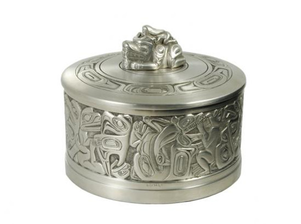 Round pewter box with West Coast First Nations' woman and bear design and pewter lid ornament.