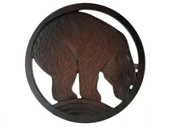 Red-brown bear in a circular frame.
