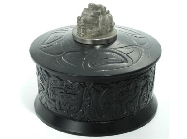 Round black marble box with West Coast First Nations' design and pewter lid ornament.
