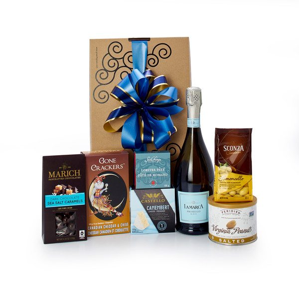 Gourmet gift basket featuring La Marca Prosecco, and sweet and savoury snacks (chocolate, crackers, nuts, etc.), packaged in signature Green & Green gift box with ribbon and bow.