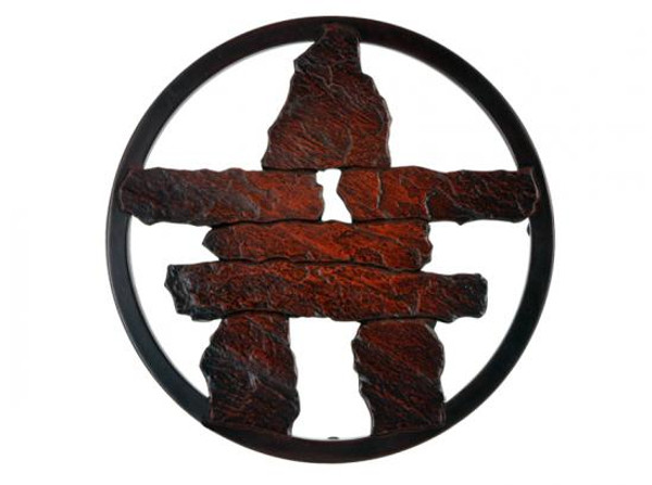Red-brown inukshuk in a circular frame.
