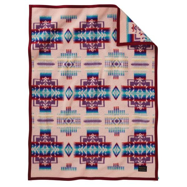Pendleton blanket with Chief Joseph print in pink and blue.
