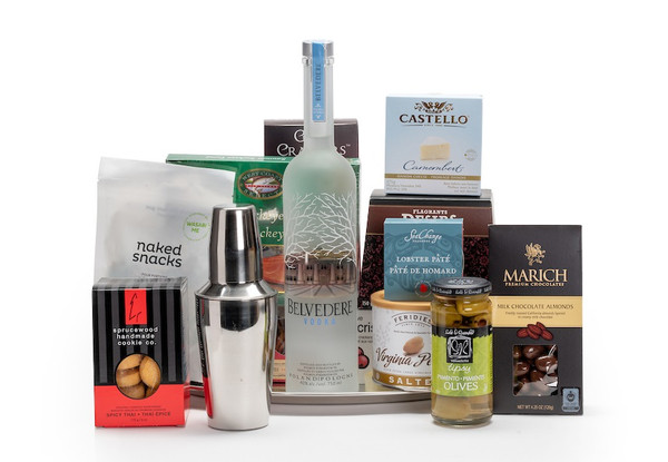Gourmet gift basket featuring Belvedere vodka, a martini shaker, and snacks (crackers, cheese, pate, etc.).