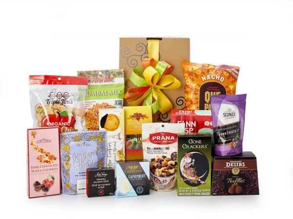 Gourmet gift basket featuring sweet and savoury snacks (chocolate, cookies, crackers, nuts, etc.) packaged in signature Green & Green gift box with ribbon and bow.