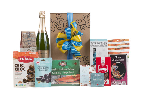 Gourmet gift basket featuring Blue Mountain Gold Label Brut Sparkling Wine, and sweet and savoury snacks (chocolate, crackers, nuts, etc.), packaged in signature Green & Green gift box with ribbon and bow.