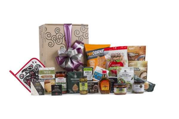 Selection of pantry staples from meals to snacks, sweet and savory items wrapped in Green & Green signature gift box.