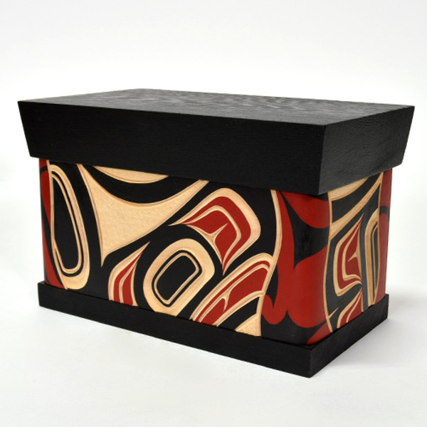 """Eagle ChestSize: 9"""" x 5.5"""" x 5""""  Carved and painted steam bent yellow cedar with red cedar top and bottom   Design meaning: Honor. Power. Leadership  Bentwood boxes are one of the most outstanding items manufactured by Native people of the Pacific Northwest Coast, including parts of southern Alaska, western British Columbia and southern Washington. Made by kerfing and steam bending a single plank to form four sides, the containers with a height greater than their width are called boxes, while those with a length greater than their height are referred to as chests. Historically, boxes came in various sizes from small (measured in inches) to massive (large enough to provide seating). Some undecorated, others carved or painted or both. The highly decorated ones were symbols of wealth. Fishermen used boxes shaped to fit into their canoes to carry tackle and supplies. Some were used for cooking (filled with water and hot stones) while others were used for storage of food, clothing, tools, or supplies."""
