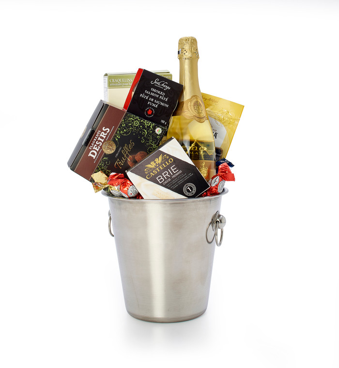 Gourmet gift basket featuring Chamdeville brut, and sweet and savoury snacks (chocolate, crackers, cheese, etc.), presented in a champagne bucket.