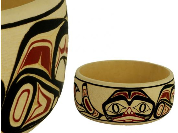 Potlatch bowl carved in West Coast First Nations dogfish design, with red, black, and cream colours.