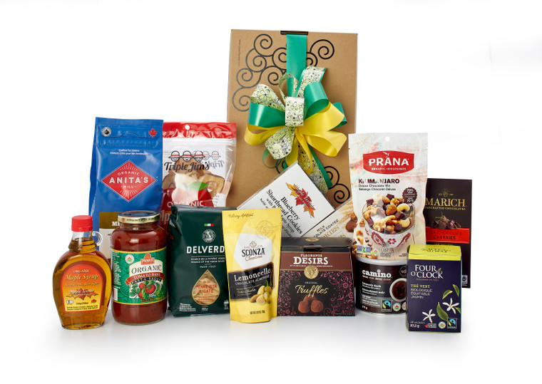 Gourmet gift basket featuring healthy snacks (quick oats, cookies, nuts, tea, crackers, etc.) packaged in signature Green & Green gift box with ribbon and bow.