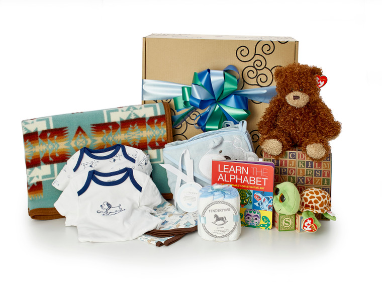 Gift basket for new baby, featuring Pendleton blanket, blue clothing, teddy bear and other toys.