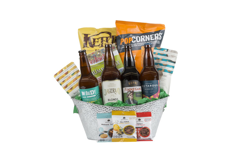 Beer basket containing four handpicked 650mL local beer paired with savory snacks.