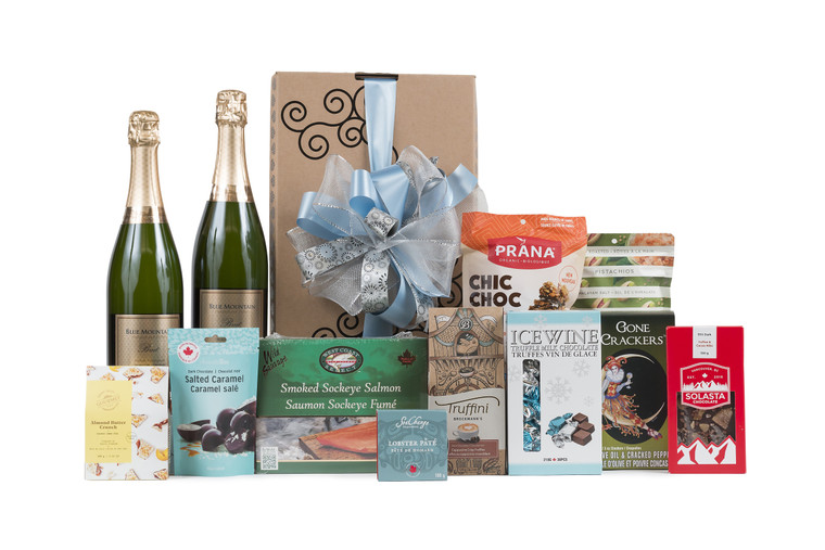 Gourmet gift basket featuring two bottles of Blue Mountain Gold Label Brut Sparkling Wine, and sweet and savoury snacks (chocolate, crackers, nuts, etc.), packaged in signature Green & Green gift box with ribbon and bow.