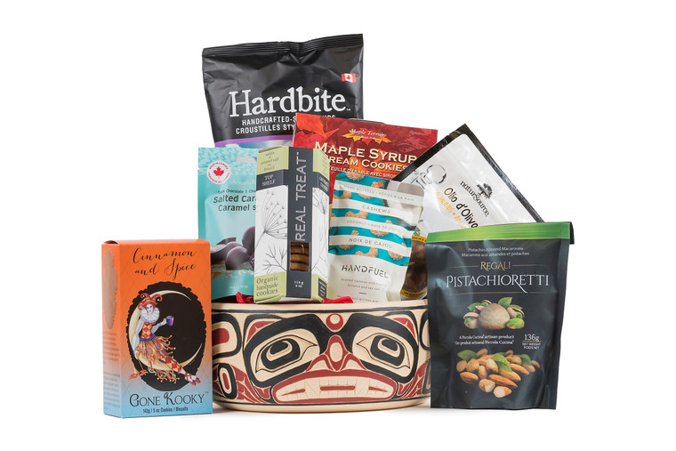 Local products  wrapped with 10 inch carved potlatch bowl.