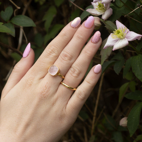 model wearing gold friendship band ring