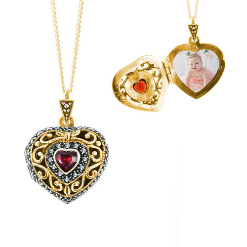 front view of gold heart shaped locket with garnet gem and 1 photograph fitted inside